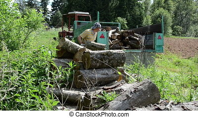 trailer worker logs - worker working in the forest on a...