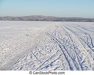 trails on the lake in winter
