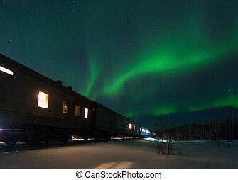 train and aurora borealis over the tundra, Russia