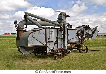 Train and Threshing Machine - A freight trains passes behind...