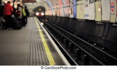 Train approaching at the platform of the underground, London
