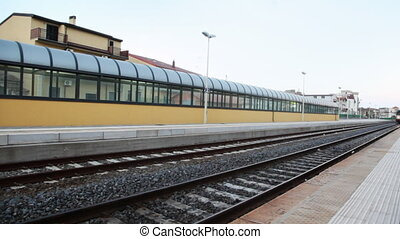 Train arrive to platform near railway station - train arrive...