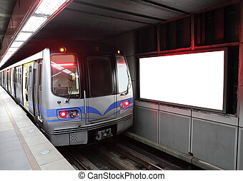 train at metro station with billboard - commuter train at...