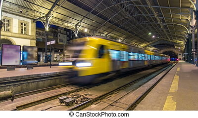 Train at platform of  Sao Bento Train Station timelapse in Porto, Portugal.