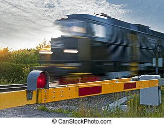 Train at railway crossing - Locomotive passing at a railway...