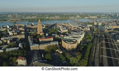 Train bridge and rail roads with train in Riga City Slowmotion drone Flight near bridge with cars traffic air flight above
