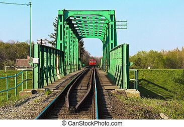 Train bridge on river with train