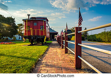 Train car outside the train station in New Oxford,...