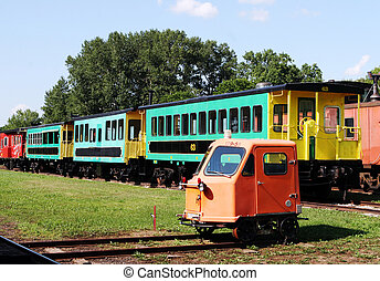 Colorful train carriages at a railway station.