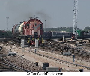 Train carrying oil in the tanks approaches and passes.