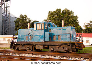 Train Cart Side View - Train head car stopped on tracks near...