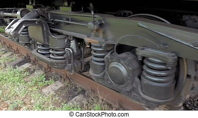 Train coach carriage wheels on rails runway