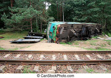 Train crash - Fatal train crash. Derailed locomotive laying...