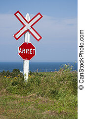 train crossing sign - a red and white train crossing stop...