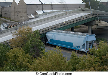 Photo of railcar crushed under the weight of the collapsed 35W bridge deck