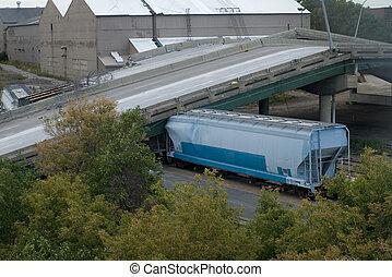 Train Crushed Under 35W Bridge - Photo of railcar crushed...
