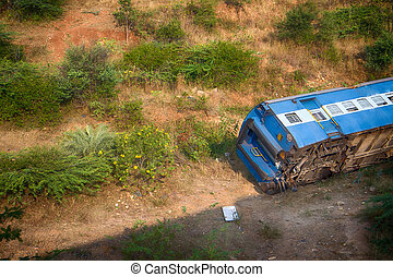 train derailed and fell off embankment in railway.