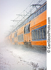 Train driving in a snow storm in the Netherlands