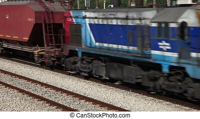 Train - Freight train passing by close up.