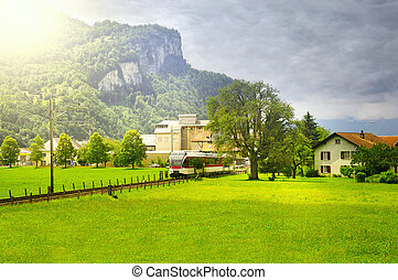 Train from Interlaken approach to Meiringen. Switzerland.