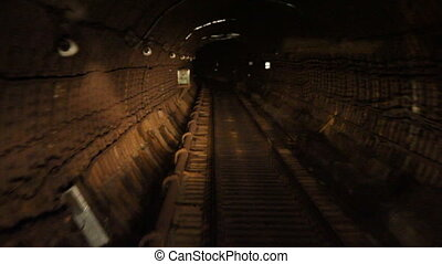 Train goes subway tunnel
