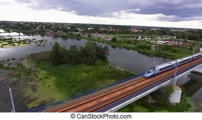 train going on bridge over river