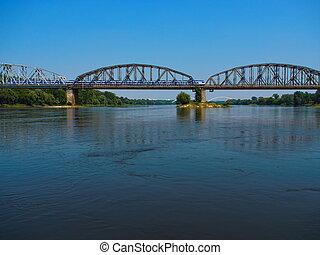 Train going on the bridge