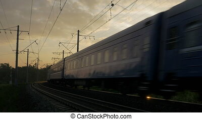 Train going through the rural area at sunset