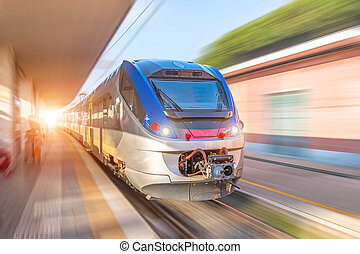 Train high speed rides on a trip at the railway station in the city