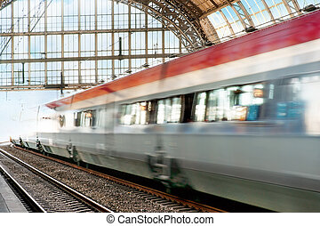 Train in blurred motion leaving a station