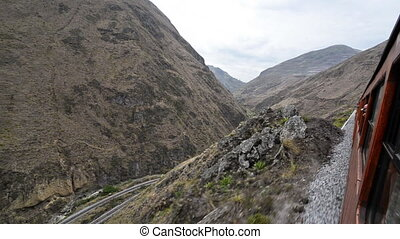 Train in Ecuador - Train passing through a canyon near...