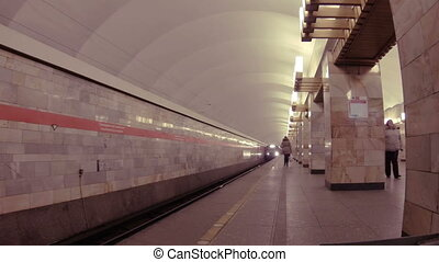 Train in the subway. Embarkation and disembarkation of...