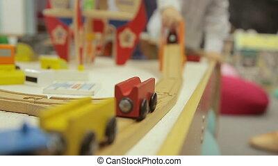 train, jouet, jeux, main bois, enfants, railway., enfant, train., garçon, tient, jouer