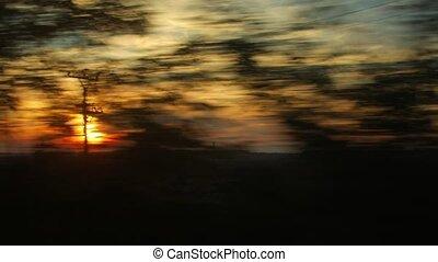 Train journey sunset light - Train window view with dramatic...