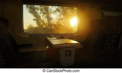 Train journey sunset light - Train view with flashing...