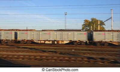 Train journey window view - Passing by freight trains at the...