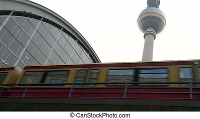 Train leaving Alexanderplatz Station by the Television Tower, Berlin, Germany