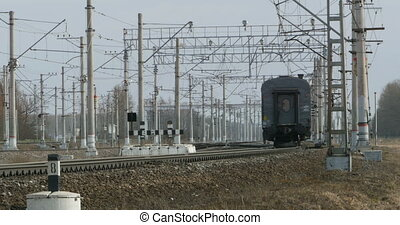 train leaving into the distance - railway track, passenger...