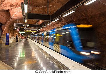 Train leaving Radhuset metro station in Stockholm