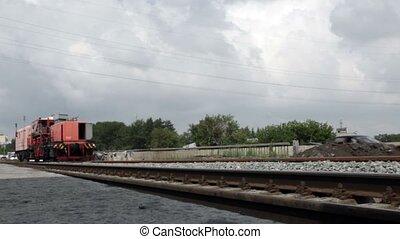Train - Locomotive moves by rail.