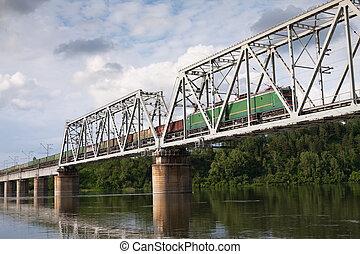 Train - locomotive pulling a freight train on the railway...