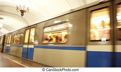 train moving away from subway station and hides in tunnel