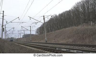 Train moving on the railway in the Ukrainian field. 4K
