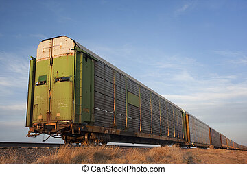 train of old stock rail cars for livestock transportation -...