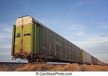 train of old stock rail cars for livestock transportation -...
