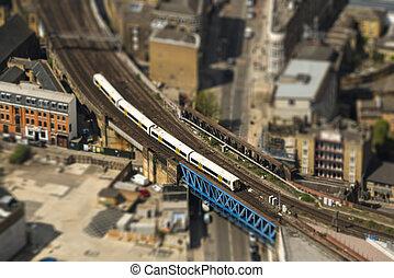 Train on a bridge in London, tilt-shift effect
