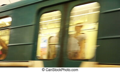 train on big speed arrives on at subway station