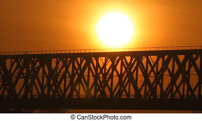 Train on the bridge at sunset. Rail