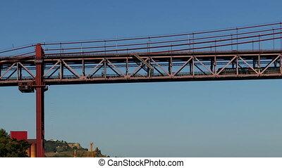 Train on the Lower Level 25 de Abril Bridge in Lisbon -...