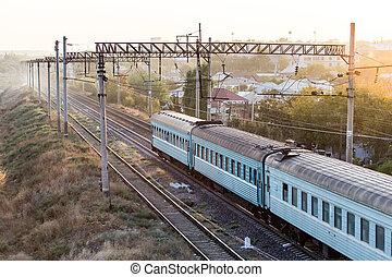 train on the railway at sunset
